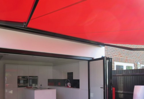 Electric Awning in Red Made and fitted by Awingsouth