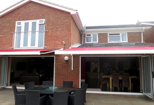 Red Bifold Door Awnings Fitted in Porchester