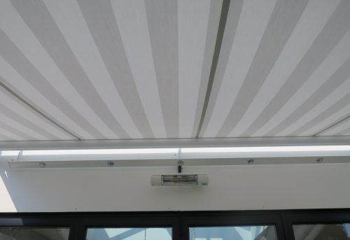 Outdoor heater and lights fitted to awning in Gosport, Hampshire by Shuttersouth