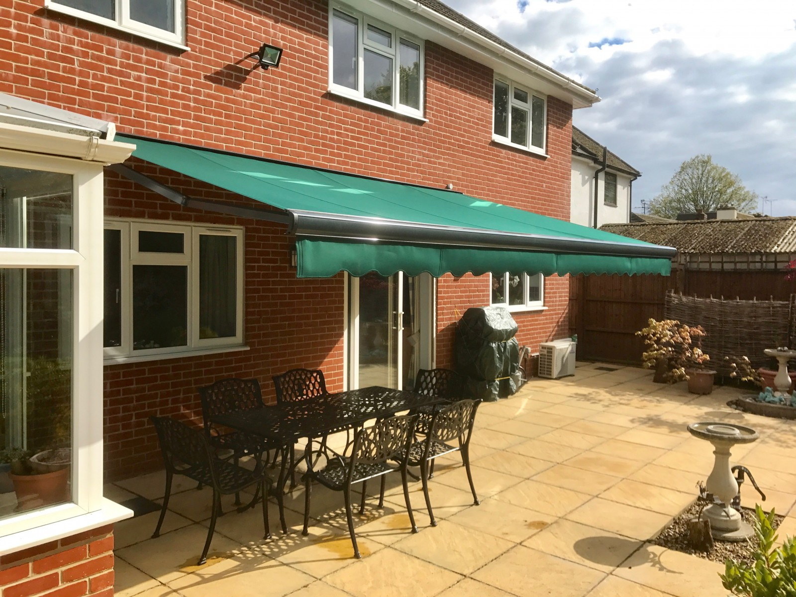 Green Patio Awning Fitted in Fleet - Awningsouth