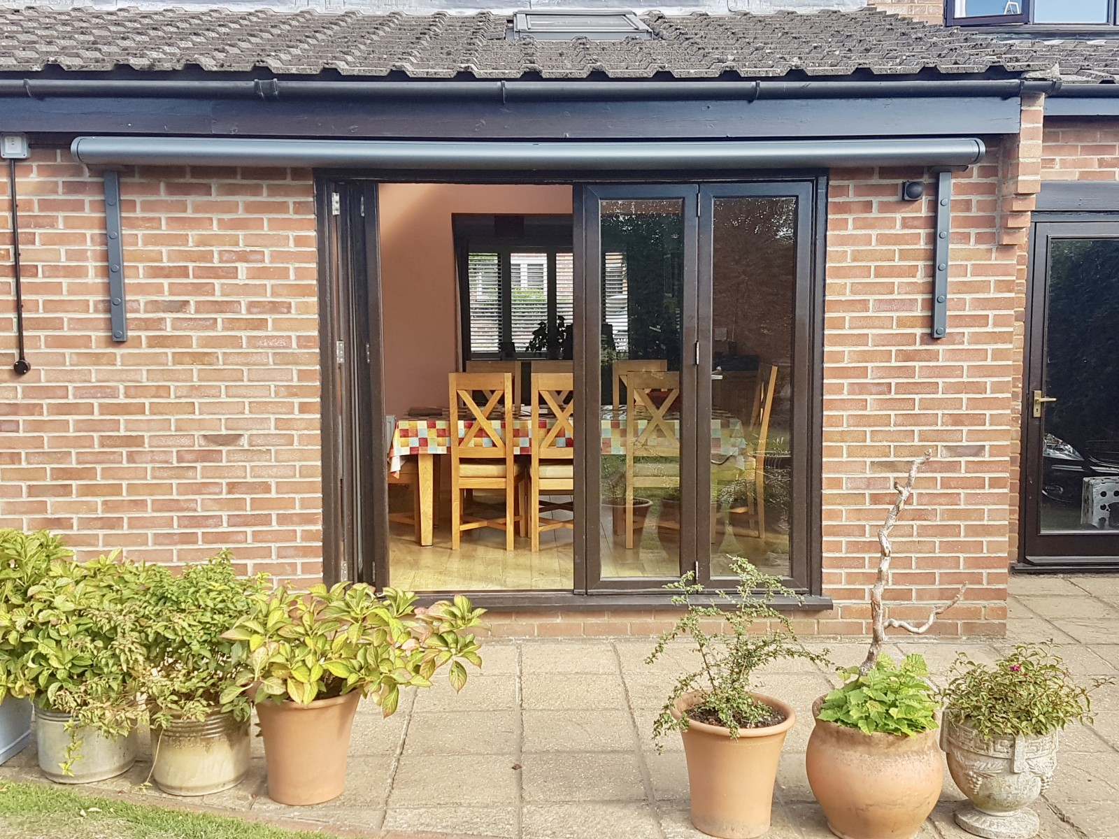 Bifold Door Awning Fitted in Romsey, Hampshire by Anwingsouth