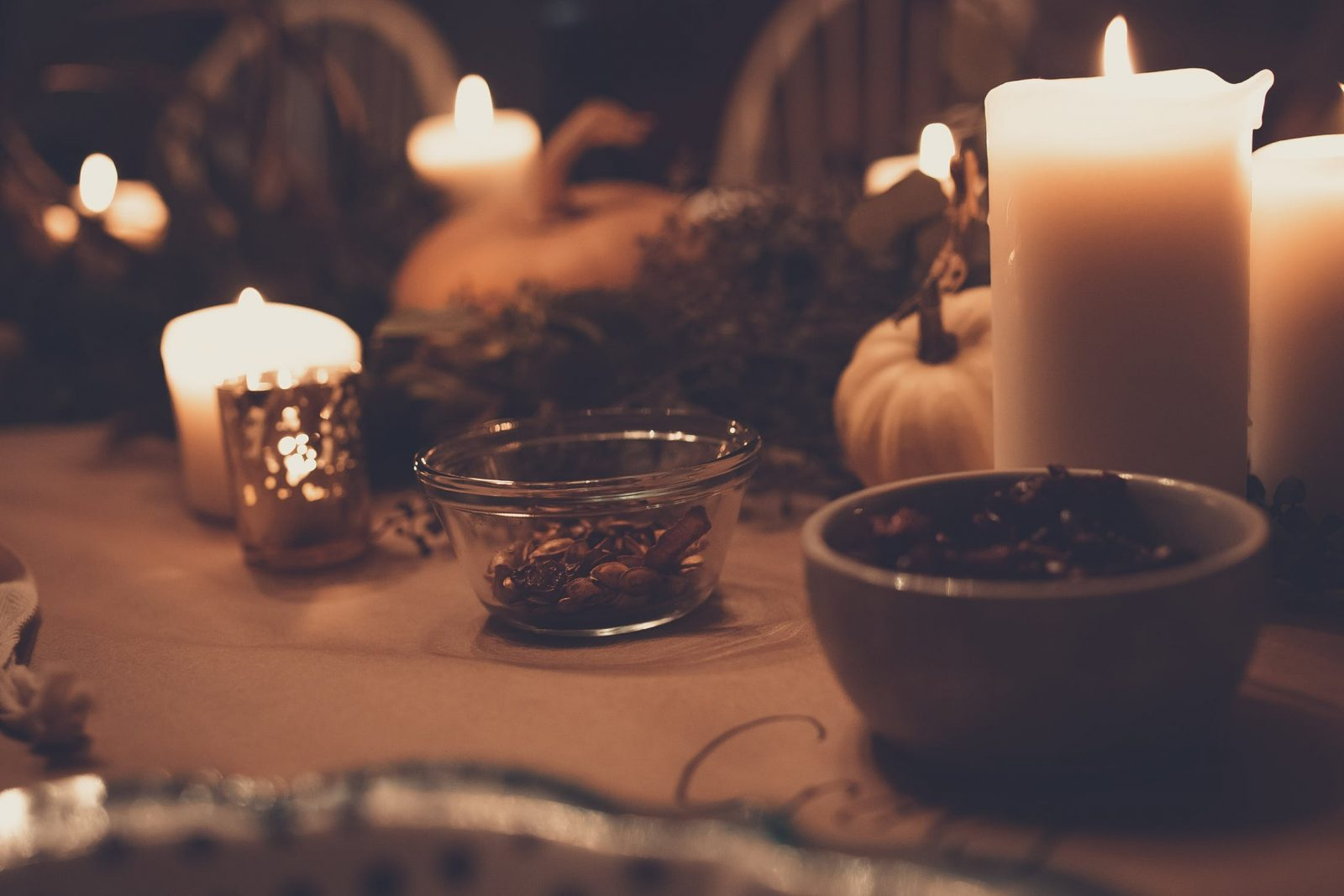 Pumpkins and Candles on Table - Make the Most of Your Awning This Winter - Awningsouth