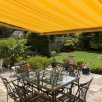 Yellow Opal Weinor Awning Fitted in Ferdown Dorset - Garden View - Awningsouth