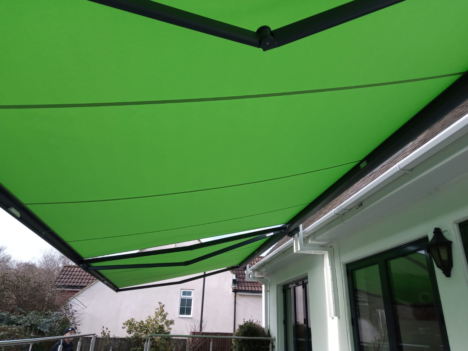Green Decking Awning Fitted by Awningsouth