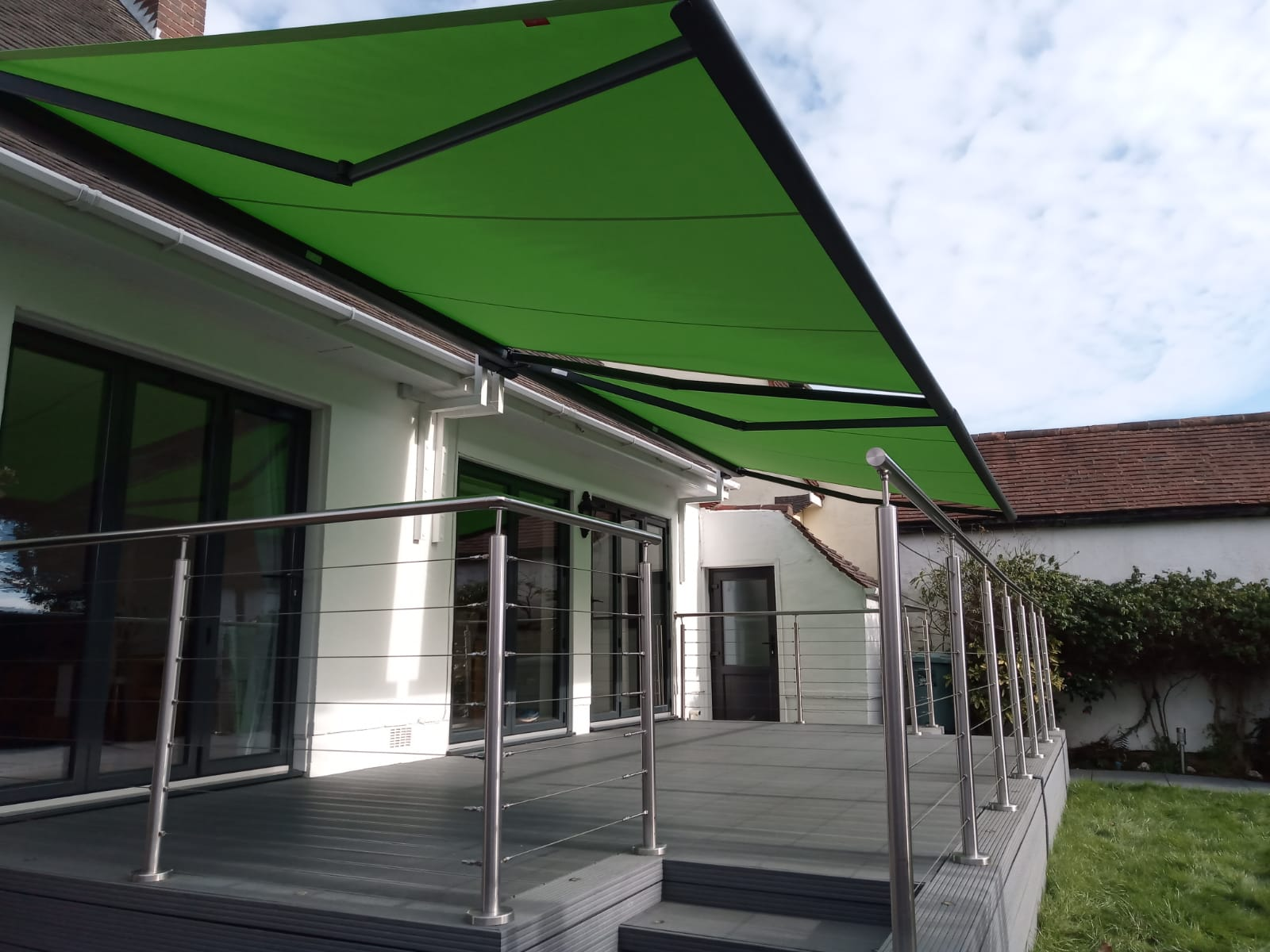 Modern Green Garden Awning Fitted by Awningsouth